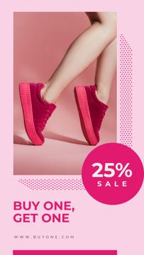Female legs in pink sneakers