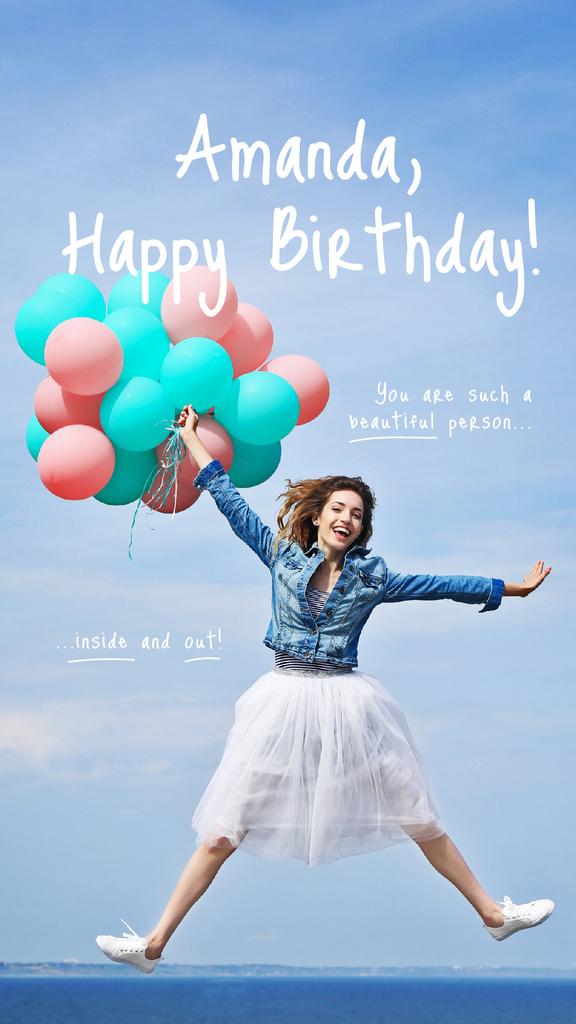 Woman holding colorful balloons — Crea un design