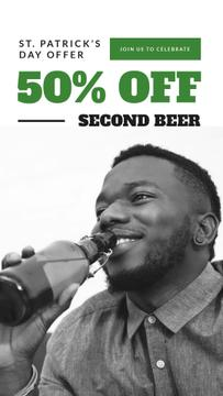 African American Man drinking beer on Saint Patrick's Day
