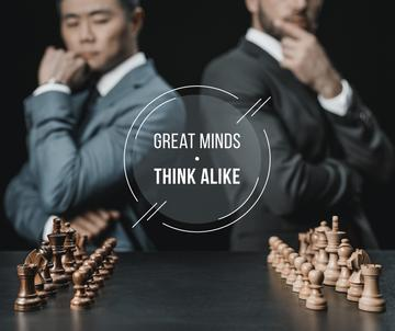 Quote on Chess Table in Front of Two Businessmen
