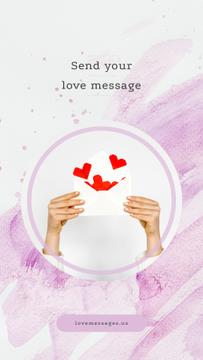Hands with envelope with paper hearts