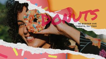 Girl holding doughnut
