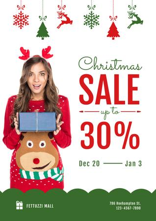 Ontwerpsjabloon van Poster van Christmas Sale with Woman Holding Present