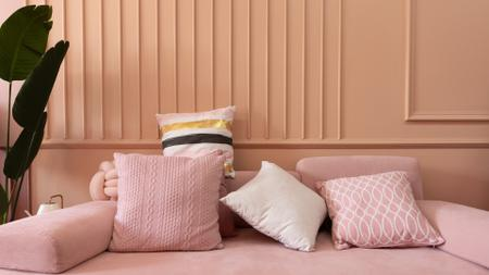 Designvorlage Pillows on Sofa in pink room für Zoom Background