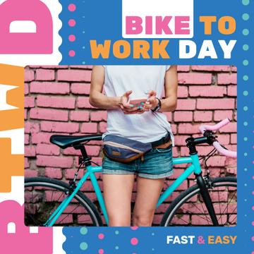 Girl with bicycle in city on Bike to work Day