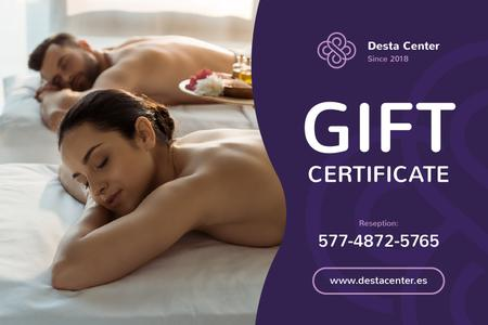 Ontwerpsjabloon van Gift Certificate van Spa Center Offer with Woman and Man at Massage