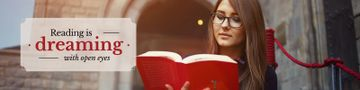 Beautiful young woman reading book with inspirational quote