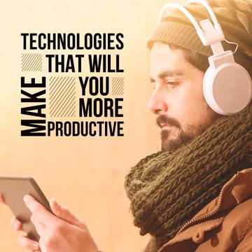 Man in headphones watching video on the tablet