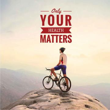 Cyclist on top of mountain with inspirational quote