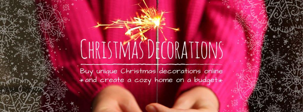 Shiny sparkler in hands on Christmas — Créer un visuel
