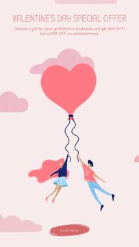 Couple flying on heart balloon