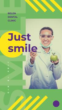 Smiling Dentist holding apple