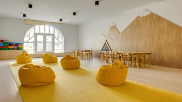 Cute Nursery Interior with soft yellow armchairs