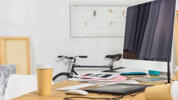 Home Workplace with bike and cups of Coffee