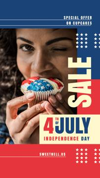 Woman Eating Independence Day Cupcake