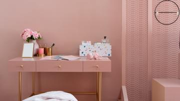 Cosmetics on table in pink Room