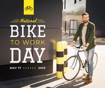Man with bicycle in city on Bike to Work Day