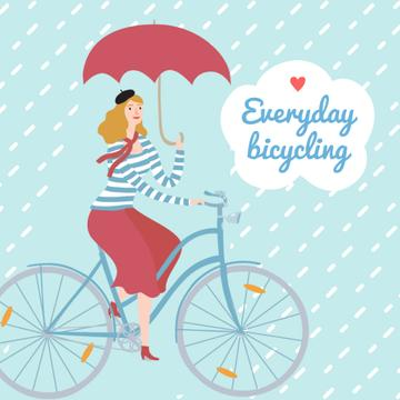 Woman Riding Bicycle With Umbrella
