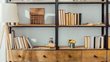 Wooden shelves with Books and Flowers