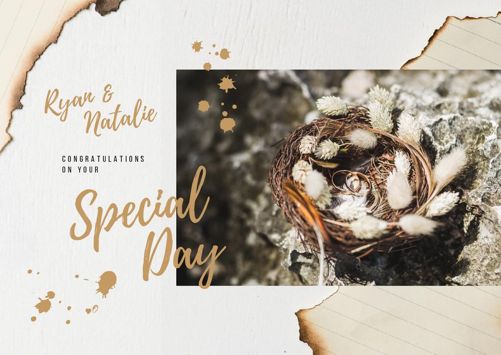Golden wedding rings in nest — Maak een ontwerp