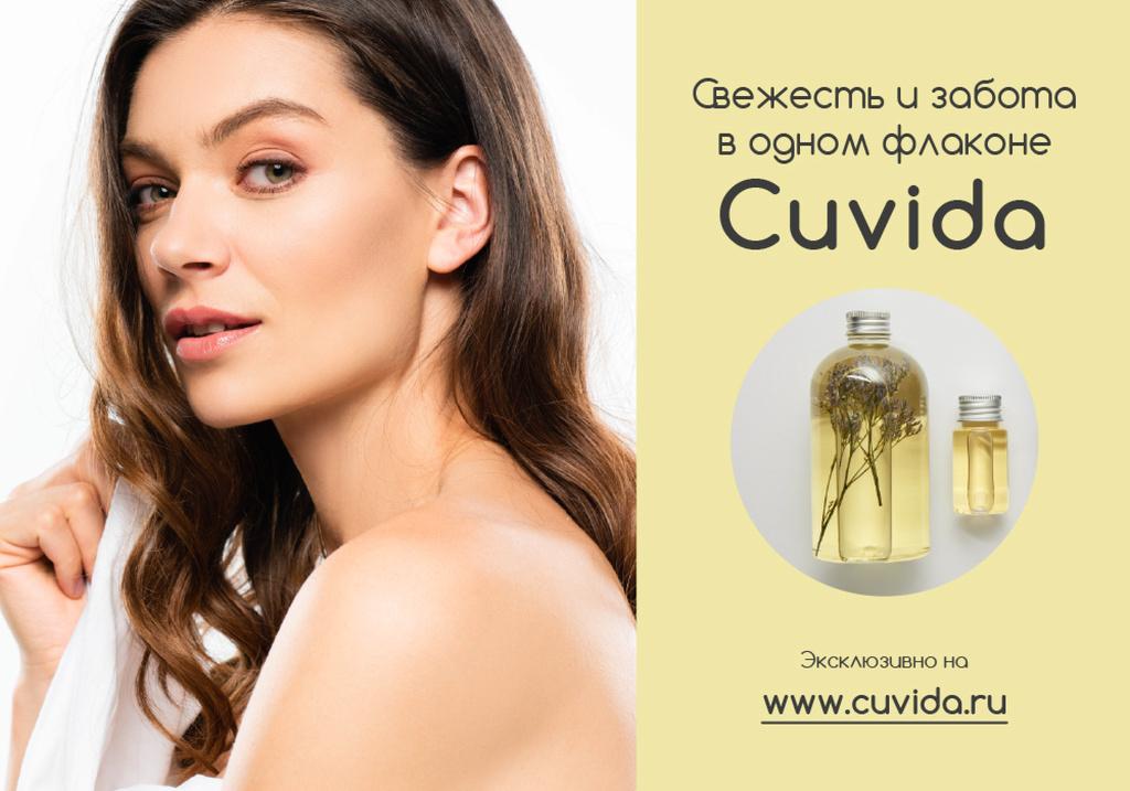 Woman with Skincare Oil in Bottles — Crea un design
