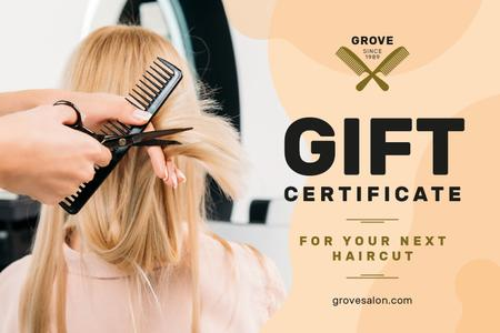 Template di design Hair Studio Ad with Hairstylist Cutting Hair Gift Certificate