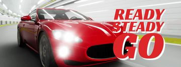 Red sports car driving fast