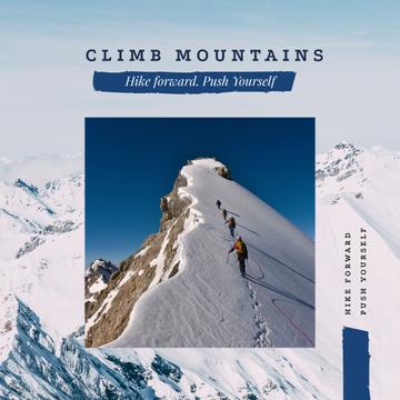 Climbers walking on snowy peak