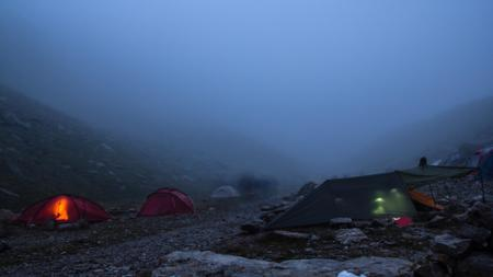 Tent town in the foggy Mountains Zoom Background Modelo de Design