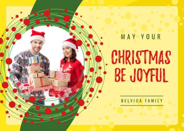 Plantilla de diseño de Merry Christmas Greeting Couple with Presents Card