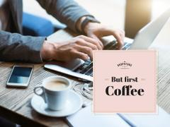 Man typing on Laptop with coffee