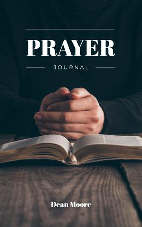 Man Praying by Bible Book Cover Modelo de Design