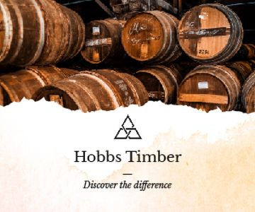 Timber Ad Wooden Barrels in Cellar