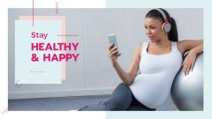 Pregnant woman listening music on phone