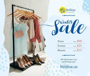 Winter Sale Offer Clothes on Hanger