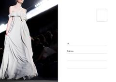 Young woman wearing white dress on catwalk