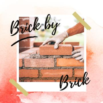 Builder building brick wall