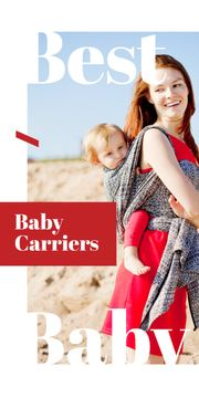 Happy mother with kid in carrier