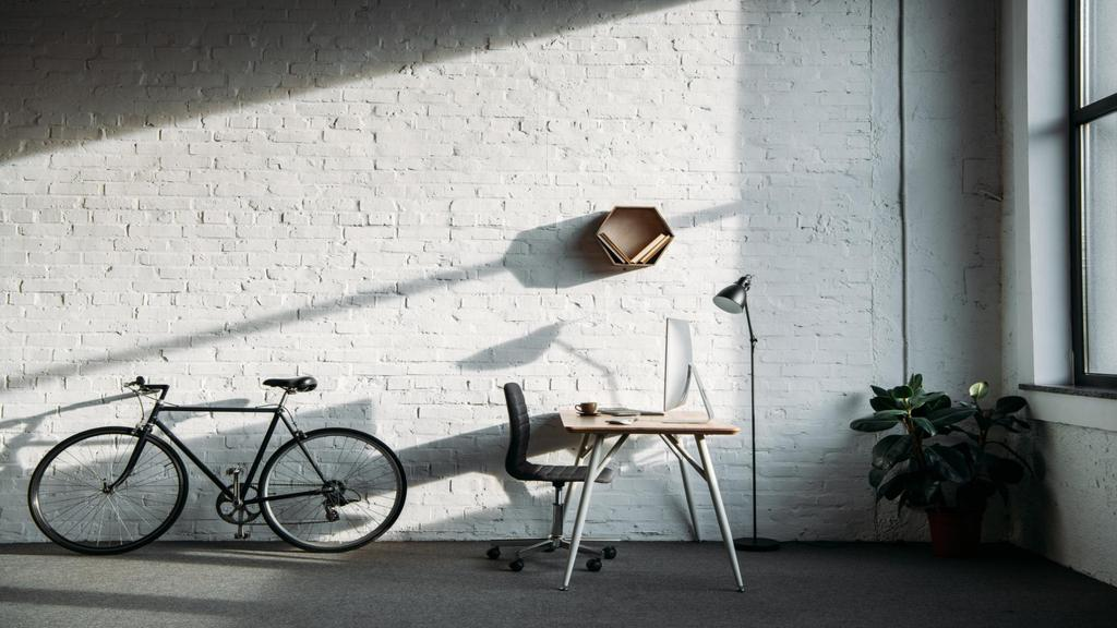 Cozy Home Workplace with Bike and Flower — Créer un visuel