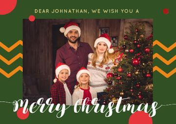 Merry Christmas Greeting with Family by Fir Tree