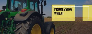 Processing wheat with tractor in field