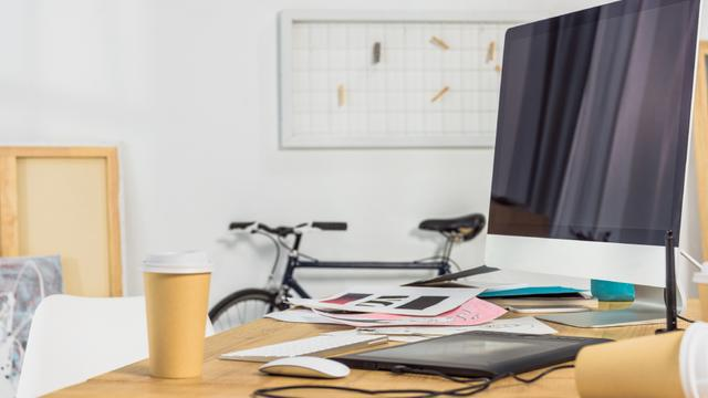 Plantilla de diseño de Home Workplace with bike and cups of Coffee Zoom Background