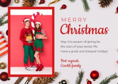 Ontwerpsjabloon van Postcard van Merry Christmas Greeting Couple with Presents