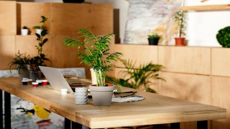 Plantilla de diseño de Workplace wooden Interior with candle and Flower Zoom Background