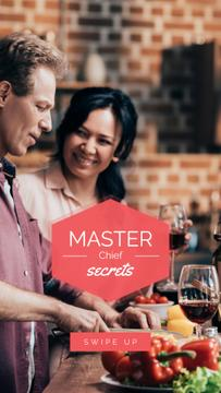 Couple cooking at Kitchen with Wine