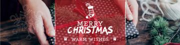 Merry Christmas Greeting with Woman wrapping Gift