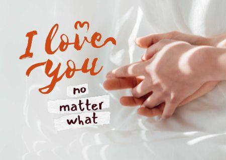 Platilla de diseño Cute Love Phrase with Couple holding Hands Card
