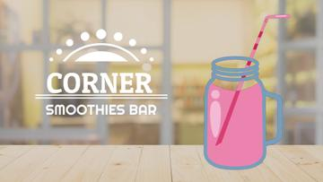 Pink drink in glass jar on table