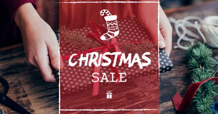 Template di design Christmas Sale with Woman wrapping Gift Facebook AD
