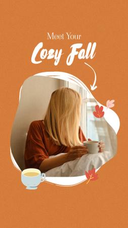 Platilla de diseño Autumn Inspiration with Woman under Blanket holding Cup Instagram Story
